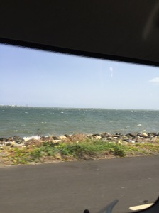 The road from the airport runs right along the coastline.